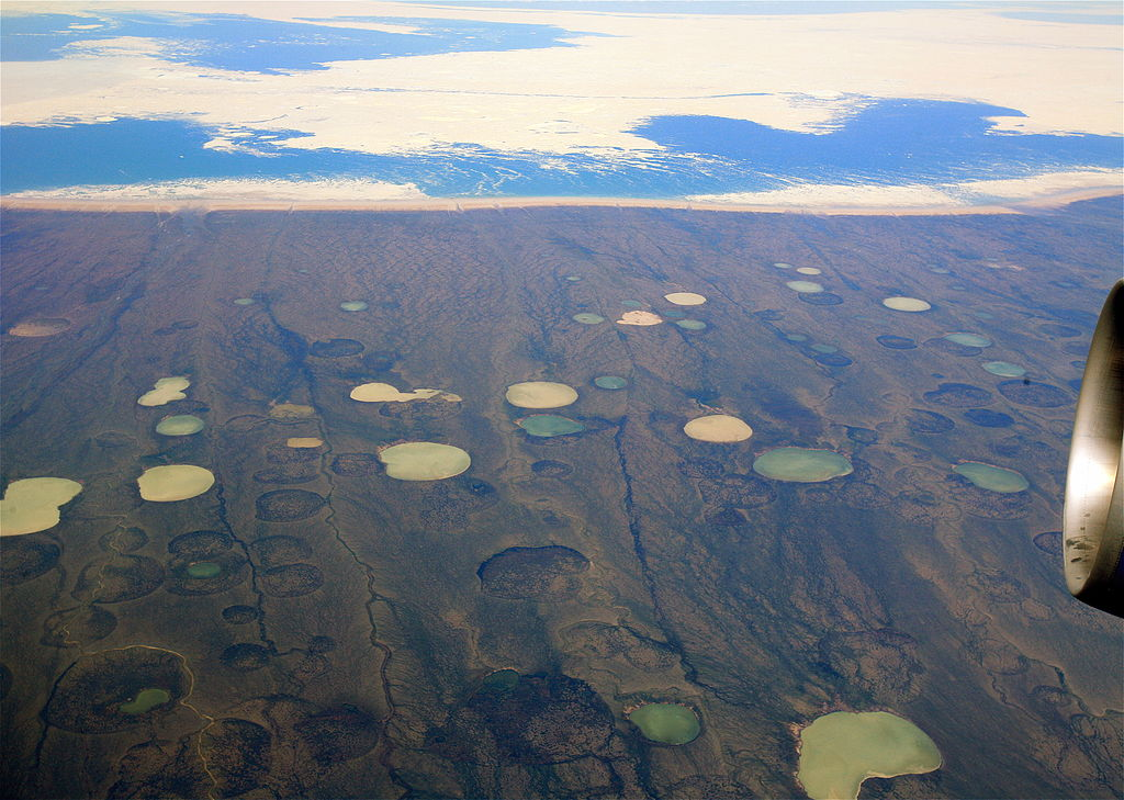 """Permafrost thaw ponds in Hudson Bay Canada near Greenland"" by Steve Jurvetson - http://www.flickr.com/photos/44124348109@N01/2661598702 en:Flicker.com. Licensed under CC BY 2.0 via Wikimedia Commons."