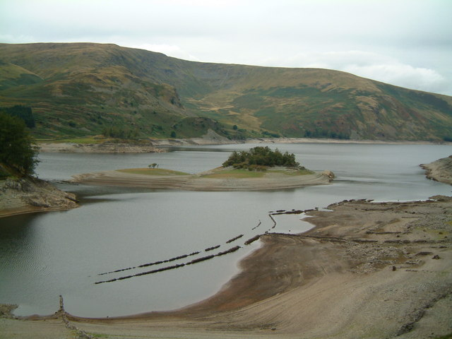 """Wood Howe island, Haweswater Reservoir - geograph.org.uk - 301396"" by John Douglas. Licensed under CC BY-SA 2.0 via Commons."
