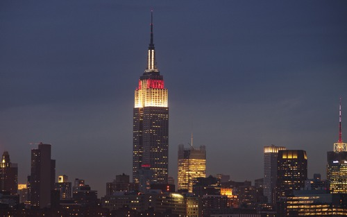 The Empire State Building is lit in red and white to raise awareness for the disaster in Japan, in New York