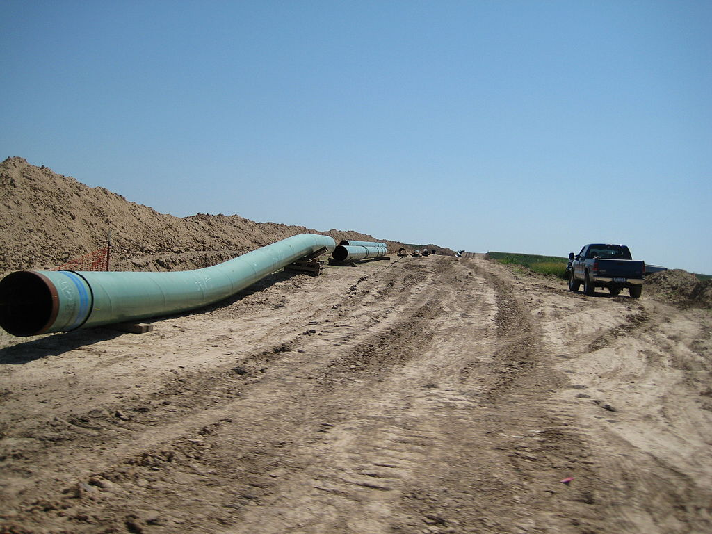 """Pipes for keystone pipeline in 2009"" by shannonpatrick17 from Swanton, Nebraska, U.S.A. - keystone pipeline. Licensed under CC BY 2.0 via Commons."
